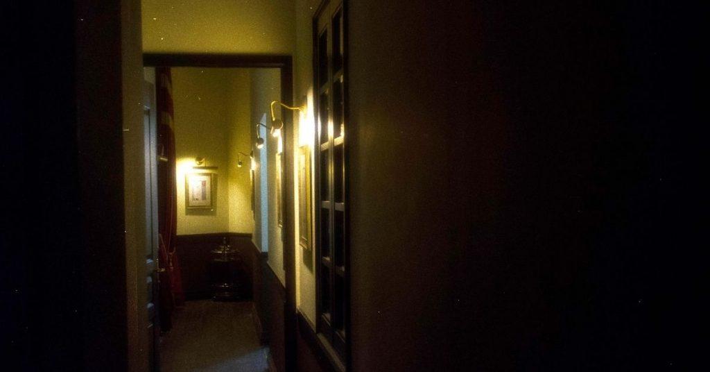 Hauntu hotel hallway that looks haunted